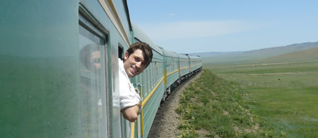 honors student riding train in central asia