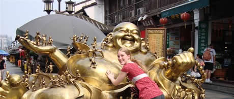 Ashley rubbing the Buddha for good luck in China