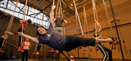 student participating in a trapeze workshop