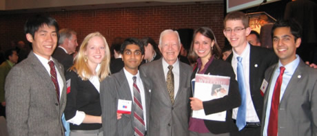 President Carter meeting with student researchers at symposium