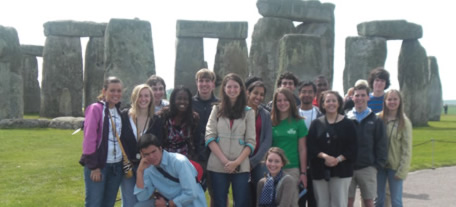 students in front of stonehenge