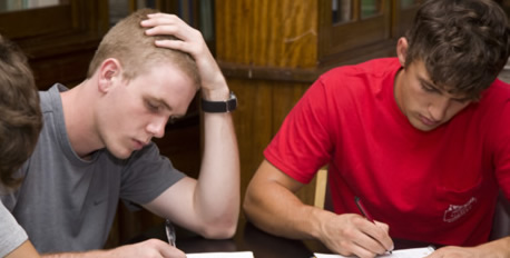 two Honors students filling out forms