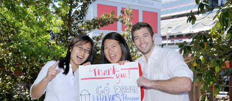 honors students on campus holding a sign thanking donors for their support
