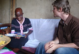 Fulbright Scholar Jeremy Akin working with a young student in Uganda
